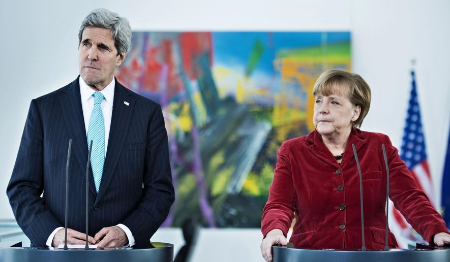 ** FILE ** U.S. Secretary of State John Kerry, left, and German Chancellor Angela Merkel, irght, address the media at the Chancellery in Berlin, Germany, Firday, Jan. 31, 2014. (Associated Press)