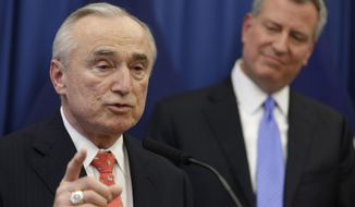 FILE -  In this Dec. 5, 2013 file photo, William Bratton, left, speaks while New York Mayor Bill de Blasio looks on during a news conference in New York introducing Bratton as de Blasio's choice for New York City police commissioner.  Presiding over his first promotion ceremony on Friday, Jan. 31, 2014, Bratton told his audience that he's committed to reshaping the NYPD's crime-fighting strategy of aggressive street stops to make it more respectful of the public. He also said he wants more collaboration with the powerful Patrolmen's Benevolent Association.(AP Photo/Seth Wenig, File)