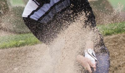 Matt Jones hits from bunker on the 12th hole during second round action at the Waste Management Phoenix Open at the TPC Scottsdale, Friday, Jan. 31, 2014. (AP Photo/The Arizona Republic, Tom Tingle)  MARICOPA COUNTY OUT; MAGS OUT; NO SALES