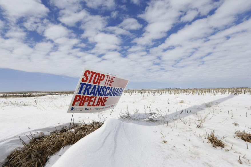 "FILE - In this March 11, 2013, file photo, a sign reading ""Stop the Transcanada Pipeline"" stands in a field near Bradshaw, Neb. The proposed Keystone XL pipeline will run through this field.  In a move that disappointed environmental groups and cheered the oil industry, the Obama administration on Jan. 31, 2014, said it had no major environmental objections to the proposed Keystone XL oil pipeline from Canada.    (AP Photo/Nati Harnik)"
