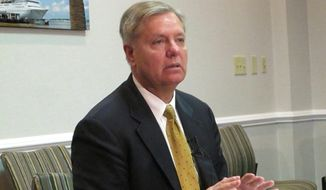 FILE - In this March 18, 2013 file photo, U.S. Sen. Lindsey Graham meets with reporters in Charleston, S.C. Graham's campaign announced on Friday, Jan. 31, 2014 that the candidate has $7.6 million in campaign funds in the bank while fellow Republican U.S. Sen. Tim Scott has $3.1 million for next fall's campaign, giving them a formidable money advantage over their opponents. (AP Photo/Bruce Smith, File)