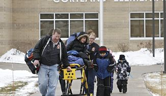 FILE - In this Jan. 14, 2014 file photo, a young boy is taken on a stretcher from Cortland Elementary School in Cortland, Ill., after noxious gases released from the nearby landfill got caught in the school's ventilation system making dozens of students and teachers nauseous. None of the injuries or illnesses were life threatening. A DeKalb County judge has ordered Waste Management of Illinois, Inc., to take precautions to ensure that it doesn't happen again. (AP Photo/Daily Chronicle, Rob Winner)  MANDATORY CREDIT