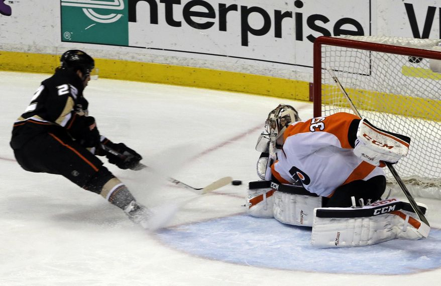 Anaheim Ducks center Mathieu Perreault (22) gets an assist on this goal by Patrick Maroon, not shown, against Philadelphia Flyers goalie Steve Mason (35) during the first period of an NHL hockey game in Anaheim, Calif., Thursday, Jan. 30, 2014. (AP Photo)