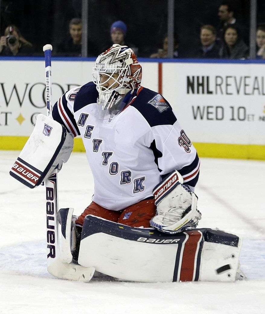 New York Rangers goalie Henrik Lundqvist (30), of Sweden, stops a shot on-goal during the first period of an NHL hockey game against the New York Islanders, Friday, Jan. 31, 2014, in New York. (AP Photo/Frank Franklin II)