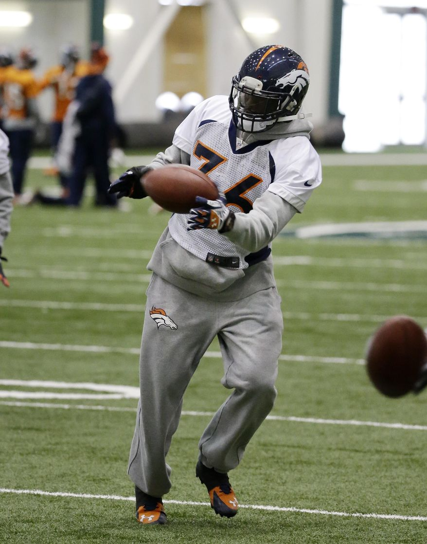 Denver Broncos cornerback Kayvon Webster  grabs a pass during practice Friday, Jan. 31, 2014, in Florham Park, N.J. The Broncos are scheduled to play the Seattle Seahawks in the NFL Super Bowl XLVIII football game Sunday, Feb. 2, in East Rutherford, N.J. (AP Photo/Mark Humphrey)