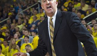 Purdue head coach Matt Painter reacts and shouts by his bench in the second half of an NCAA college basketball game against Michigan in Ann Arbor, Mich., Thursday, Jan. 30, 2014. Michigan won 75-66. (AP Photo/Tony Ding)