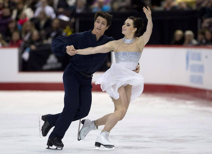 FILE - In this Jan. 11, 2014 file photo, Scott Moir and Tessa Virtue perform their free program in dance competition at the Canadian figure skating championships in Ottawa. The pair began skating together in 1997 when Moir was 9 and Virtue was 7, and now, after an Olympic gold medal in 2010 and two world titles, they're expected to retire after Sochi, closing the book on a partnership that has spanned nearly two decades. (AP Photo/The Canadian Press, Adrian Wyld, File)