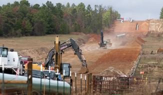 Crews work on construction of the TransCanada Keystone XL Pipeline near County Road 363 and County Road 357, east of Winona, Texas on Dec. 3, 2012.  (Associated Press)