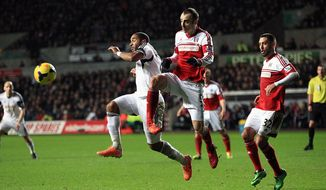 Fulham's Dimitar Berbatov, right, and Swansea City's Ashley Williams battle for the ball during their English Premier League soccer match at the Liberty Stadium, Swansea, Wales, Tuesday, Jan. 28, 2014. (AP Photo/Nick Potts, PA Wire)   UNITED KINGDOM OUT  -  NO SALES  -  NO ARCHIVES