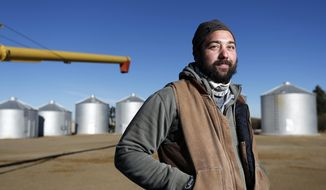 In this Jan. 28, 2014 photo, Matt Myers, 29, is the farm manager of the family farm 13 miles west of Big Sandy, Mont., where they grow spring and winter wheat. Myers grew up on the four-generation, 103-year-old farm and first drove a truck during harvest as a third-grader. (AP Photo/The Great Falls Tribune, Larry Beckner)