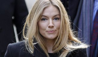 "FILE- This Thursday, Nov. 24, 2011 file photo shows British actress Sienna Miller in London. Miller told Britain's phone-hacking trial on Friday Jan. 31 2014 she had a ""brief encounter"" with James Bond star Daniel Craig, but insists a British tabloid misconstrued the nature of the relationship based on a hacked voicemail message.    (AP Photo/Lefteris Pitarakis, FILE)"