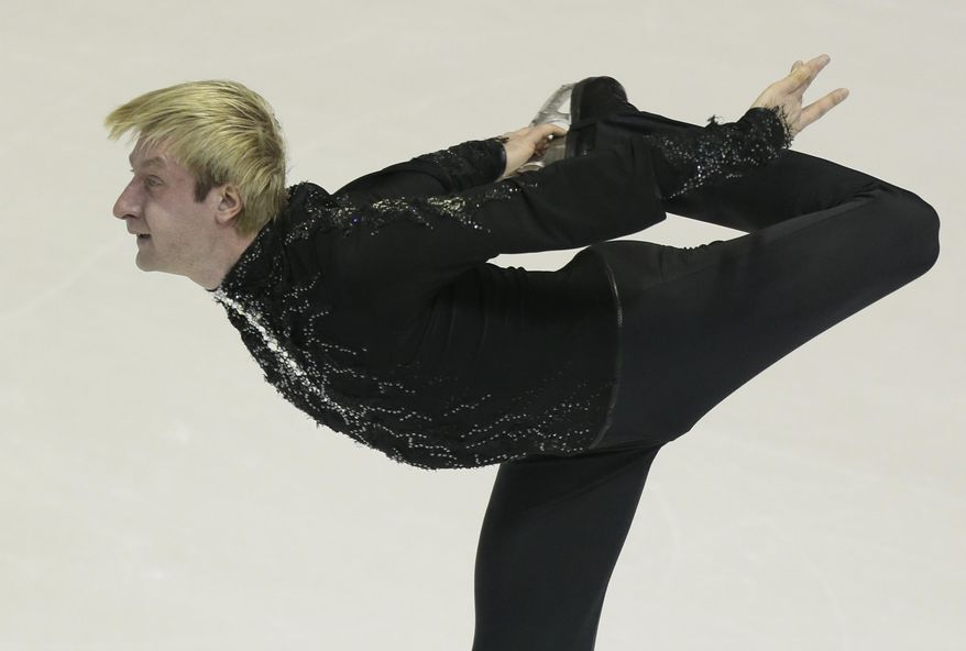 FILE - In this Jan. 24, 2013, file photo, Evgeni Plushenko of Russia skates his short program at the ISU European figure skating championship in Zagreb, Croatia. Although he's one of the world's predominant figure skaters, with an Olympic gold and two silvers to his name, Plushenko has barely been seen in competition for the past year. The performance that won him Russia's sole berth in the men's singles for the 2014 Winter Olympics in Sochi, Russia, was done behind closed doors. (AP Photo/Ivan Sekretarev, File)