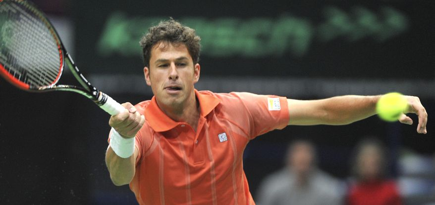 Robin Haase from the Netherlands returns the ball to Radek Stepanek from the Czech Republic during their opening single of the tennis Davis Cup 1st round match in Ostrava, Friday, Jan. 31, 2014. (AP Photo/CTK, Jaroslav Ozana) SLOVAKIA OUT
