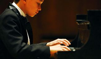 In this April 28, 2012 photo, James Wilson performs a recital at the University of Wyoming Fine Arts Auditorium in Laramie, Wyo. Wilson, 12, has been playing the piano since age 3 and will perform Friday, Jan. 31, 2014, at the Lagny-sur-Marne International Piano Competition outside Paris. The Casper Star-Tribune reports that Wilson is one of just two Americans playing in the competition. (AP Photo/Casper Star-Tribune, Dan Cepeda)