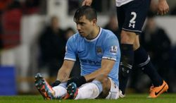 Manchester City's Sergio Aguero sits on the field injured before being substituted off during the English Premier League soccer match between Tottenham Hotspur and Manchester City at White Hart Lane stadium in London, Wednesday, Jan. 29, 2014.  (AP Photo/Matt Dunham)
