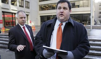 Mason Tvert, right, spokesman for the Marijuana Policy Project, prepares to deliver a petition to National Football League headquarters, Wednesday, Jan. 29, 2014, in New York. Kevin Fitzgerald, left, director of building security, waits for the handoff. Tvert's organization is asking the NFL to allow its players to use marijuana in states where it is legal to do so. The Seattle Seahawks play the Denver Broncos, Sunday, Feb. 2, in the Super Bowl. Both Washington and Colorado have legalized marijuana use. (AP Photo/Mark Lennihan)