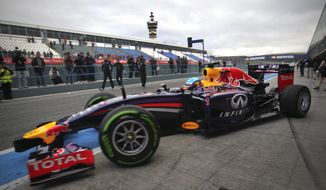 Infiniti Red Bull Racing driver Sebastian Vettel of Germany exits his garage to drive his new RB10 Formula One car at the Circuito de Jerez on Tuesday, Jan. 28, 2014, in Jerez de la Frontera, Spain. (AP Photo/Miguel Angel Morenatti)
