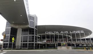 This May 24, 2013, file photo shows the empty Delta airlines terminal 3 at JFK airport in New York. (AP Photo/Mary Altaffer, File)