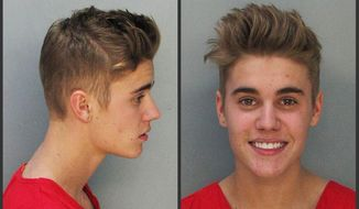 FILE - These Jan. 23, 2014 police booking mugs made available by the Miami Dade County Corrections Department show pop star Justin Bieber. A South Florida officer is under investigation for attempting to take a photograph of Justin Bieber while he was in custody, Thursday, Jan. 23, on DUI and other charges. Miami Beach police Sgt. Bobby Hernandez confirmed Friday, Jan. 31, that a female officer is being investigated for possible conduct unbecoming an officer. Bieber and singer Khalil were arrested Jan. 23, for allegedly drag-racing on a Miami Beach Street.  (AP Photo/Miami Dade County Jail)