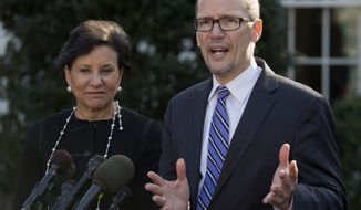 ** FILE ** Commerce Secretary Penny Pritzker, left, and Labor Secretary Thomas Perez speak to the media outside the West Wing of the White House, Friday, Jan. 31, 2014, in Washington, after an event in the East Room of the White House about the long-term unemployed. (AP Photo/Carolyn Kaster)