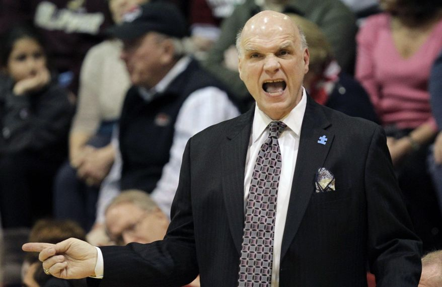 St Josephs' coach Phil Martelli shouts from the sideline in the first half of an NCAA college basketball game with Massachusetts, Saturday, Feb. 1, 2014, in Philadelphia.  (AP Photo/Laurence Kesterson)