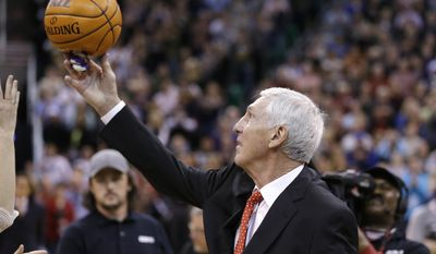 Former Jazz coach Jerry Sloan releases the ball after raising his banner during a banner ceremony honoring Jerry Sloan at the EnergySolutions Arena Friday, Jan. 31, 2014, in Salt Lake City. (AP Photo/Rick Bowmer)