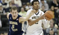 Wake Forest's Devin Thomas (2) steals the ball from Georgia Tech's Daniel Miller (5) during the first half of an NCAA college basketball game in Winston-Salem, N.C., Saturday, Feb. 1, 2014. (AP Photo/Chuck Burton)