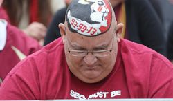 Florida State fan Bill Keen sports a Seminole logo during a celebration for the BCS-champion football team, Saturday, Feb. 1, 2014, in Tallahassee, Fla. (AP Photo/Tallahassee Democrat, Mike Ewen) NO SALES
