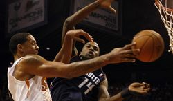 Charlotte Bobcats small forward Michael Kidd-Gilchrist (14) fouls Phoenix Suns power forward Channing Frye (8) in the third quarter during an NBA basketball game on Saturday, Feb. 1, 2014, in Phoenix. (AP Photo/Rick Scuteri)