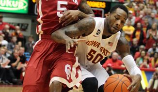 Oklahoma guard Je'lon Hornbeak (5) runs into Iowa State guard DeAndre Kane (50) during the first half of an NCAA college basketball game in Ames, Iowa, Saturday, Feb. 1, 2014. (AP Photo/Justin Hayworth)