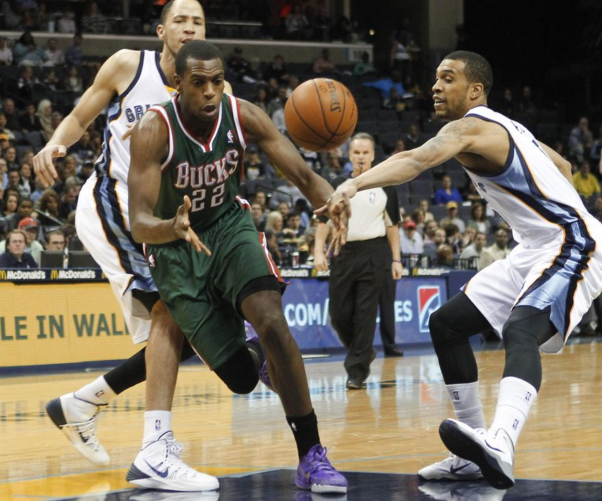Memphis Grizzlies forward Courtney Lee, right, and forward Tayshaun Prince, back left, strip the ball from Milwaukee Bucks forward Khris Middleton (22) in the first half of an NBA basketball game on Saturday, Feb. 1, 2014, in Memphis, Tenn. (AP Photo/Lance Murphey)