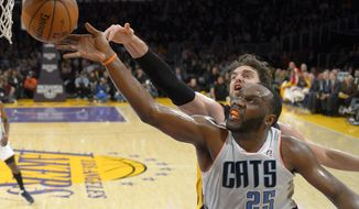 Charlotte Bobcats center Al Jefferson, right front, puts up a shot as Los Angeles Lakers center Pau Gasol, of Spain, defends during the first half of an NBA basketball game, Friday, Jan. 31, 2014, in Los Angeles. (AP Photo/Mark J. Terrill)