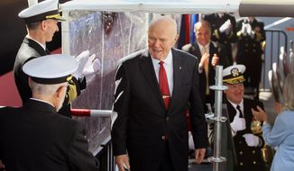 John Glenn is applauded by high ranking Naval Officers shortly after his daughter Lyn Glenn smashed the ceremonial bottle of champagne on the side of the USNS John Glenn during its christening  at General Dynamics NASSCO, Saturday Feb. 1, 2014, in San Diego, Calif.  (AP Photo/UT San Diego, Charlie Neuman) MANDATORY CREDIT