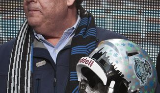 New Jersey Gov. Chris Christie holds a souvenir football helmet as he leaves after a ceremony to pass official hosting duties of next year's Super Bowl to representatives from Arizona, Saturday Feb. 1, 2014 in New York. Fellow Republicans are assessing the damage of new allegations that Gov. Christie knew about a traffic-blocking operation orchestrated by top aides.  (AP Photo/Bebeto Matthews)