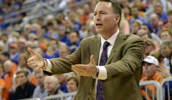 Texas A&M coach Billy Kennedy reacts during the first half of an NCAA college basketball game against Florida, Saturday, Feb. 1, 2014, in Gainesville, Fla. (AP Photo/Phil Sandlin)