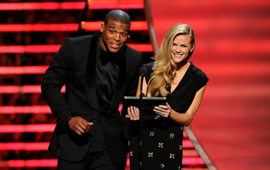 Carolina Panthers' Cam Newton, left, and model Brooklyn Decker speak on stage at the thirrd annual NFL Honors at Radio City Music Hall on Saturday, Feb. 1, 2014, in New York. (Photo by Evan Agostini/Invision for NFL/AP Images)
