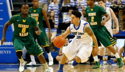 Saint Louis' Austin McBroom (2) controls the ball as George Mason's Bryon Allen (0) defends during the first half of an NCAA college basketball game Saturday, Feb. 1, 2014, in St. Louis. (AP Photo/Scott Kane)