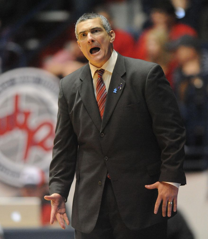 "South Carolina coach Frank Martin reacts during an NCAA college basketball game against Mississippi at the C.M. ""Tad"" Smith Coliseum in Oxford, Miss. on Saturday, Feb. 1, 2014. (AP Photo/Oxford Eagle, Bruce Newman) MAGS OUT, NO SALES MANDATORY CREDIT"