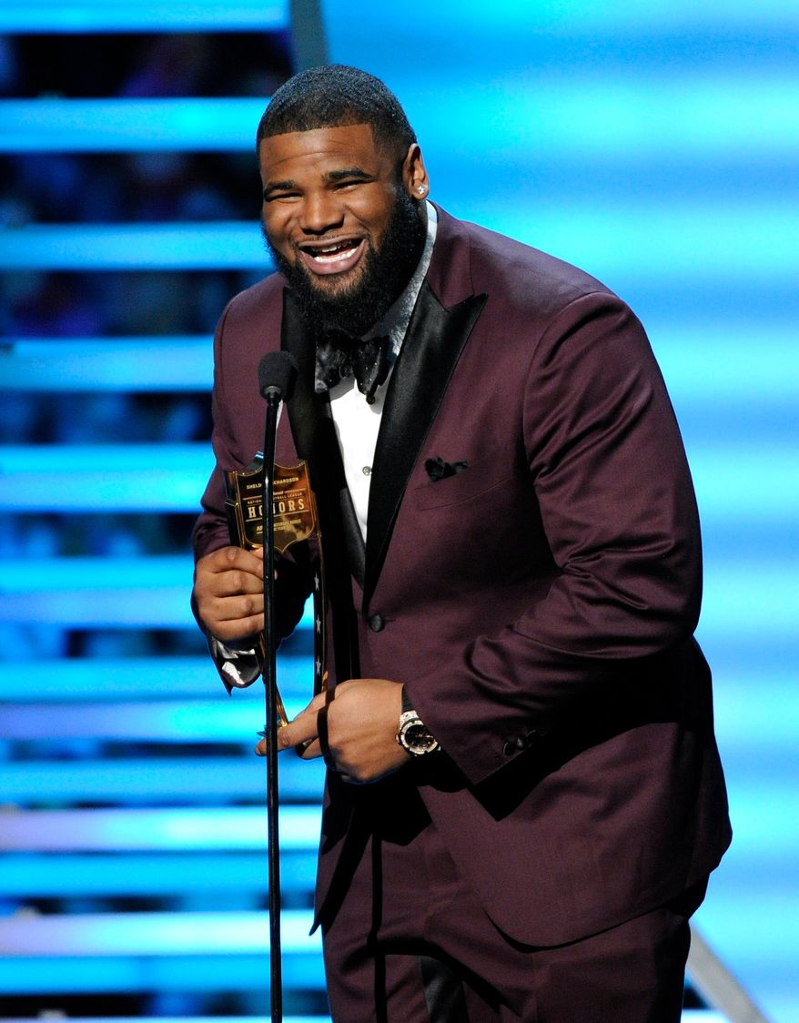 Sheldon Richardson of the New York Jets speaks after receiving the award for AP Defensive Rookie of the Year, at the third annual NFL Honors at Radio City Music Hall on Saturday, Feb. 1, 2014, in New York. (Photo by Evan Agostini/Invision for NFL/AP Images)