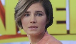 Amanda Knox prepares to leave the set following a television interview, Friday, Jan. 31, 2014 in New York. (AP Photo/Mark Lennihan) ** FILE **