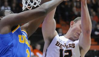 UCLA's Jordan Adams (3) loses the ball to Oregon State's Angus Brandt (12) during the first half of an NCAA college basketball game in Corvallis, Ore., Sunday, Feb. 2, 2014. (AP Photo/Greg Wahl-Stephens)