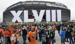 Fans arrive for the NFL Super Bowl XLVIII football game between the Seattle Seahawks and the Denver Broncos at MetLife Stadium Sunday, Feb. 2, 2014, in East Rutherford, N.J. (AP Photo/Seth Wenig)