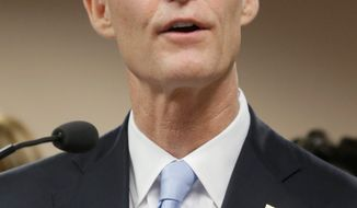 Florida Gov. Rick Scott has a fortified ground game for his re-election campaign. The Republican likely will face former Gov. Charlie Crist, a Republican turned independent turned Democrat. (Associated Press)