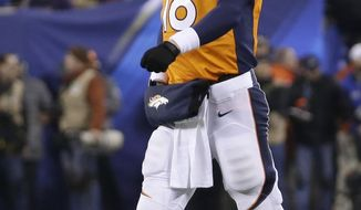 Denver Broncos' Peyton Manning walks off the field after throwing an interception against the Seattle Seahawks during the first half of the NFL Super Bowl XLVIII football game Sunday, Feb. 2, 2014, in East Rutherford, N.J. (AP Photo/Mark Humphrey)