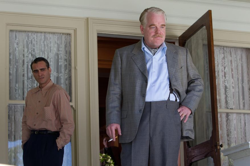 "FILE - This file film image released by The Weinstein Company shows Joaquin Phoenix, left, and Philip Seymour Hoffman in a scene from ""The Master."" Police say Phillip Seymour Hoffman was found dead in his New York City apartment Sunday, Feb. 2, 2014. He was 46.  (AP Photo/The Weinstein Company, File)"