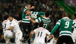 Sporting's Rojo, from Argentina,  top, jumps for the ball during their Portuguese league soccer match with Academica,  Sunday, Feb. 2 2014, at Sporting's Alvalade stadium in Lisbon. The game ended in a 0-0 draw. (AP Photo/Armando Franca)