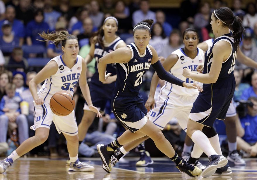 Notre Dame's Kayla McBride (21) looks for the ball as Duke's Haley Peters (33) and Richa Jackson, rear, watch with Notre Dame's Natalie Achonwa, right, during the first half of an NCAA college basketball game in Durham, N.C., Sunday, Feb. 2, 2014. (AP Photo/Gerry Broome)