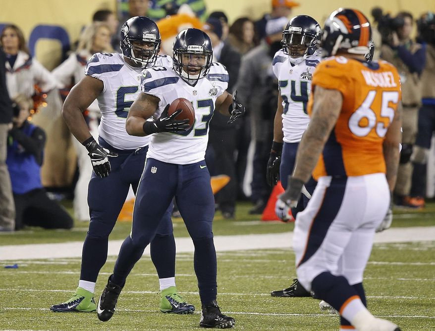 Seattle Seahawks' linebacker Malcolm Smith (53) reacts after recovering a fumble by Denver Broncos wide receiver Demaryius Thomas during the second half of the NFL Super Bowl XLVIII football game, Sunday, Feb. 2, 2014, in East Rutherford, N.J. (AP Photo/Kathy Willens)