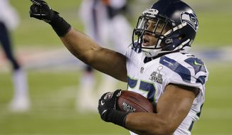 Seattle Seahawks outside linebacker Malcolm Smith (53) reacts after running back an interception for a touchdown against the Denver Broncos during the first half of the NFL Super Bowl XLVIII football game, Sunday, Feb. 2, 2014, in East Rutherford, N.J. (AP Photo/Chris O'Meara)