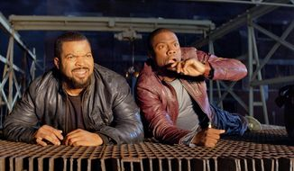 "This image released by Universal Pictures shows Ice Cube, left, and Kevin Hart in a scene from the film, ""Ride Along."" (AP Photo/Universal Pictures, file)"